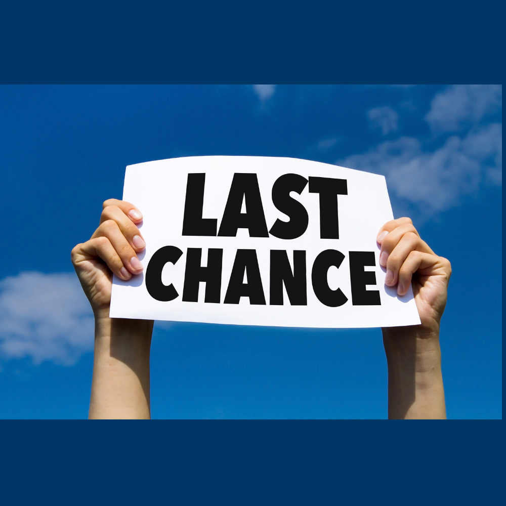 "Hands hold up sign with ""Last Chance"""